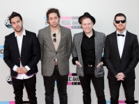 Pete Wentz, left, and Fall Out Boy arrive at the 2013 American Music Awards at the Nokia Theatre L.A. Live in Los Angeles on Sunday, November 24, 2013. (Adam Orchon/Sipa USA/MCT)