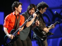 "Nick Jonas, left, Joe Jonas, center, and Kevin Jonas, right, perform during the ""We Are The Future Concert,"" Monday, Jan.19, 2009, at the Verizon Center in Washington, D.C.  (Gabriel B. Tait/MCT)"