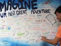 Senior Michael Estrada decorates the mural by adding his college acceptances.