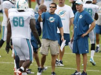 Miami Dolphins offensive coordinator Bill Lazor, middle, and head coach Joe Philbin, right, during training camp practice at Nova Southeastern University in Davie, Fla., on Saturday, Aug. 1, 2015. (Al Diaz/Miami Herald/TNS)