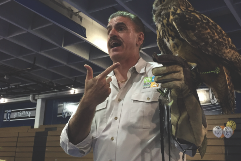 Ron Magill hold an owl for the audience to see, learn about, and take pictures with. Photo by Brooke Ellis.