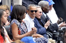 U.S. President Barack Obama with the First Family and Cuban President Raul Castro attend a baseball game on Tuesday, March 22, 2016 in Havana, Cuba. (Olivier Douliery/Abaca Press/TNS)
