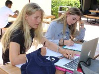 "The updated daily schedule includes flexible periods known as ""flex time,"" where students can work on projects, attend club meetings or just enjoy some down time.  Freshmen Kiara Von Gerlach and Raegan Rafool used their Flex time on Aug. 26 to catch up on work.  Photo by Monica Rodriguez"