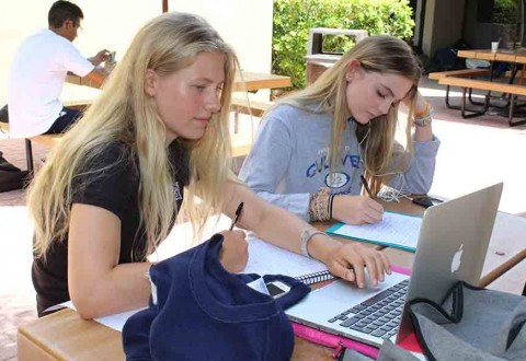 """The updated daily schedule includes flexible periods known as """"flex time,"""" where students can work on projects, attend club meetings or just enjoy some down time.  Freshmen Kiara Von Gerlach and Raegan Rafool used their Flex time on Aug. 26 to catch up on work.  Photo by Monica Rodriguez"""