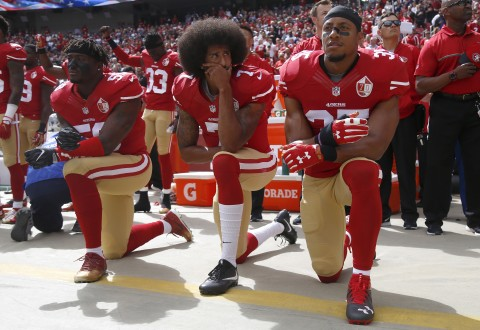From left, the San Francisco 49ers' Eli Harold, Colin Kaepernick and Eric Reid kneel during the national anthem before their NFL game against the Dallas Cowboys on October 2, 2016, at Levi's Stadium in Santa Clara, Calif. (Nhat V. Meyer/Bay Area News Group/TNS