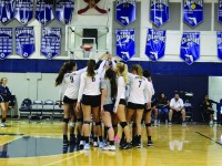 The girls volleyball team huddles up during one of their games. They currently have an 10-3 record, showing their early dominance. Key wins have come against Carrollton and Doral. Photo by Shannon Kunkel.
