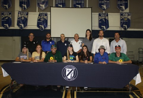 Athletes sign letters of intent on Nov. 9 at the Prep gym.  From left to right:  Lilly Barlow, Brooke Ellis, Raymond Gil, Shannon Kunkel, Sarah Lobo, Christian Nido, Robert Touron.  Back Row:  Softball Coach Mark Schusterman, Swim Coach Christopher George, Girls Basketball Coach John Zambolla, Girls Volleyball Coaches Ed Potter and Suzanne Landsom, Baseball Coach Manny Crespo.