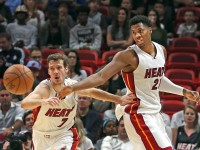 Miami Heat Goran Dragic and Hassan Whiteside chase a loose ball in the second quarter against the Boston Celtics on Monday, Nov. 28, 2016 at the AmericanAirlines Arena in Miami, Fla. (Charles Trainor Jr./Miami Herald/TNS)