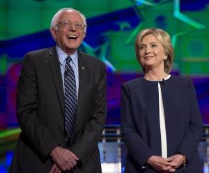 Bernie Sanders and Hillary Clinton on the debate stage on Tuesday, Oct. 13, 2015, in Las Vegas. (Brian Cahn/Zuma Press/TNS)